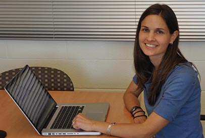 A New Literacies researcher at a laptop