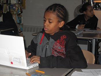 Young girl at a laptop.
